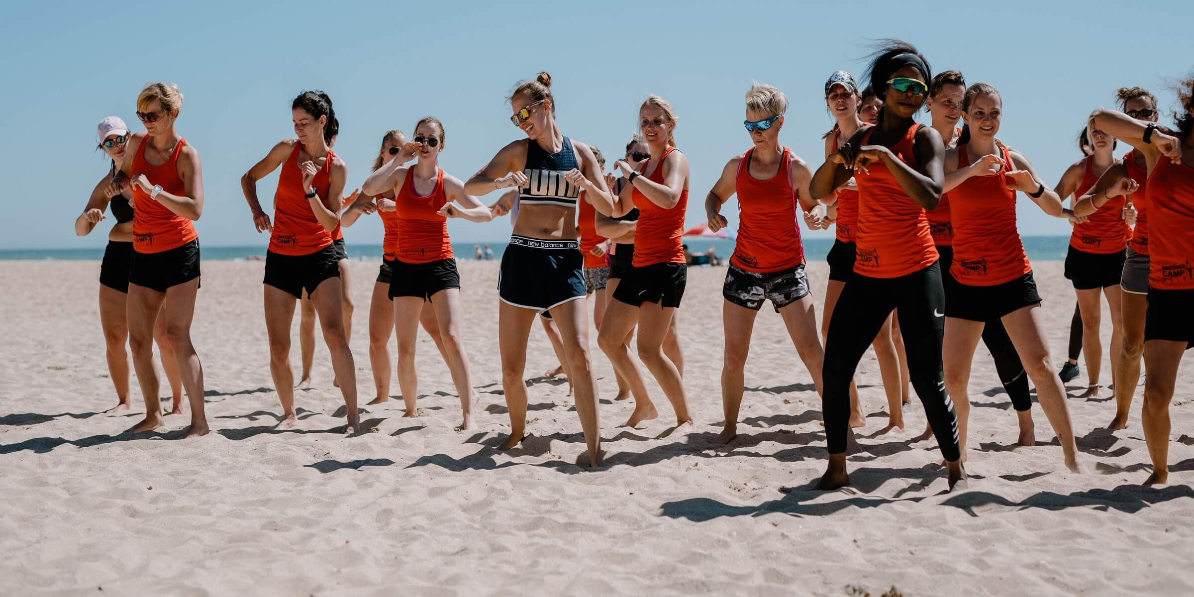 Gruppe am Strand beim Women's Health Camp